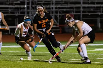 Watertown's Jordyn Forte #5 runs downfield with the ball splitting between Pomperaug defenders Mia Sullivan #35, left, and Jessica Evans #40 during a SWC Girls Field Hockey match between Watertown and Pomperaug at Pomperaug High School in Southbury on Friday. Bill Shettle Republican-American