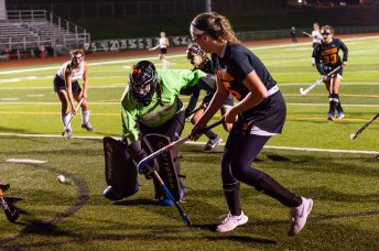 Pomperaug goalkeeper Catherine Windover #95, left ,comes out of the goal to challenge the play of Watertown's Jordyn Forte #5 during a SWC Girls Field Hockey match between Watertown and Pomperaug at Pomperaug High School in Southbury on Friday. Bill Shettle Republican-American