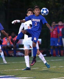 Crosby High School's Diego Vasquez knocks the ball down in front of Watertown High School's Ben Piri during the boys varsity soccer game in Waterbury on Tuesday. Emily J. Reynolds. Republican-American