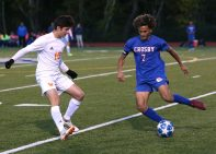 -Crosby High School captain Anthony Orellana passes the ball up the field past Watertown High School's Moni Jusufi during the boys varsity soccer game in Waterbury on Tuesday. Emily J. Reynolds. Republican-American