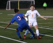 Watertown High School's Liam Farrell battles Crosby High School's Diego Vasquez for the ball during the boys varsity soccer game in Waterbury on Tuesday. Emily J. Reynolds. Republican-American