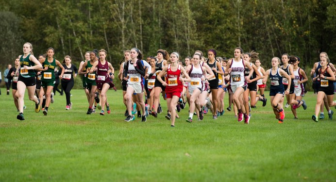 Girls varsity runners take to the course during the NVL Cross Country championships held Wednesday at Veterans Memorial Park in Watertown. Jim Shannon Republican American