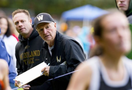 Woodland High boys and girls cross country coach Jeff Lownds watches as one of his runner make her way to the finish during the NVL Cross Country championships held Wednesday at Veterans Memorial Park in Watertown. Jim Shannon Republican American
