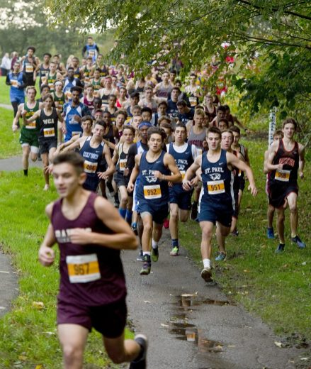 Boys varsity runners make their way down hill as they take to the course during the NVL Cross Country championships held Wednesday at Veterans Memorial Park in Watertown. Jim Shannon Republican American