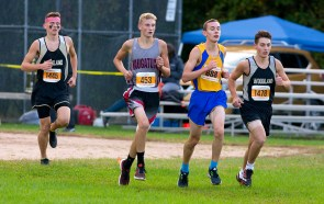 Runners from left, Greg Aldrich of Woodland, Naugatuck's Tim Bristol, Seymour's Daniel Bouzolin and Woodland's Kyle Crowell, make their way through the course during the NVL Cross Country championships held Wednesday at Veterans Memorial Park in Watertown. Jim Shannon Republican American