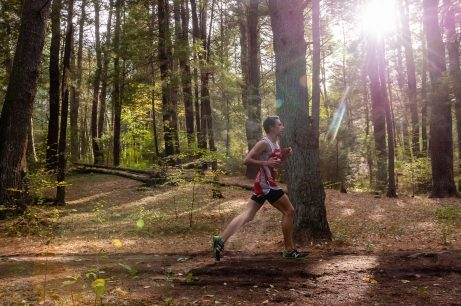 A lone runner runs through the woods part of the course during the BL Boys and Girls Cross Country Championships at Black Rock State Park in Watertown on Friday. Bill Shettle Republican-American