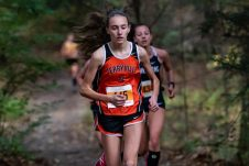 Terryville's Katie DeForest, bib #445 leads the pack through the woods at the start of the BL Boys and Girls Cross Country Championships at Black Rock State Park in Watertown on Friday. Bill Shettle Republican-American