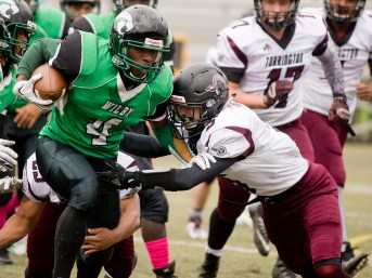 Wilby's Dylon Alleyne-Mckitty (4) gets tackled by Torrington's Jacob Coleman (5) during their NVL game Saturday morning at Municipal Stadium in Waterbury. Jim Shannon Republican American
