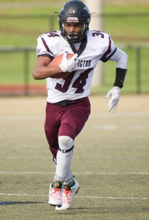 Torrington's Alaido Thompson (34) runs for a first down in their 46-0 win over Wilby Saturday morning at Municipal Stadium in Waterbury. Jim Shannon Republican American