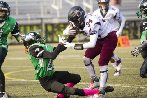 Torrington's Alaido Thompson (34) runs over Wilby's Seth Thomas (22) on his way to the end zone for a touchdown during their NVL game Saturday morning at Municipal Stadium in Waterbury. Jim Shannon Republican American