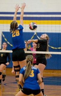 Seymour's Cathryn Ragaini (28) goes up to try and block a hit by Woodland's Sydnie Overby (33) during their NVL volleyball match Monday at Seymour High School. Jim Shannon Republican American