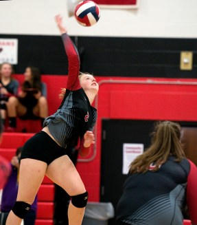 Cheshire's Mia Juodaitis (2) fire a shot over the net during their volleyball match with Sheehan Tuesday at Cheshire High School. Jim Shannon Republican American