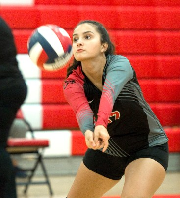 Cheshire's Ida Hoxha (37) bumps the ball to settle it during their volleyball match with Sheehan Tuesday at Cheshire High School. Jim Shannon Republican American