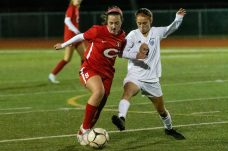 Cheshire's Kailtlyn Loura #8, left, tries to hold off Old Lyme's Kaylee Armenia #7, going for the ball during a Girls SCC Soccer game between Old Lyme and Cheshire at Cheshire High School in Cheshire on Wednesday. Bill Shettle Republican-American