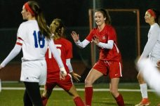 Cheshire's Caroline Campion #10, left, celebrates with her teammate Riley Petit #15, after scoring a goal to tie the score at 1-1 during a Girls SCC Soccer game between Old Lyme and Cheshire at Cheshire High School in Cheshire on Wednesday. Bill Shettle Republican-American