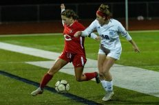 Cheshire's Ellie Pergolotti #13 tries to hold off Old Lyme's Katie Funeral #19 during a Girls SCC Soccer game between Old Lyme and Cheshire at Cheshire High School in Cheshire on Wednesday. Bill Shettle Republican-American