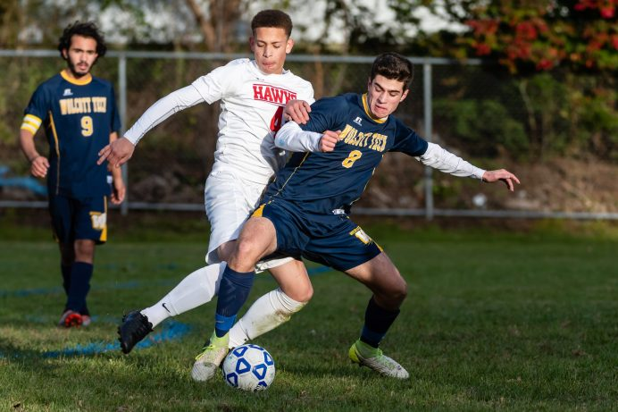 Wolcott Tech's Mark Rich #8 puts his body in front of Prince Tech's Argely's Jiminian #4, to gain control of the ball during a boys CTC soccer game between Prince Tech and Wolcott Tech at Oliver Wolcott Tech School in Torrington on Thursday. Bill Shettle Republican-American