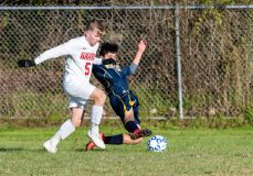 Wolcott Tech's Brian Tacuri #16 makes a sliding tackle to knock the ball away from Prince Tech's Jordan Baker #5 during a boys CTC soccer game between Prince Tech and Wolcott Tech at Oliver Wolcott Tech School in Torrington on Thursday. Bill Shettle Republican-American