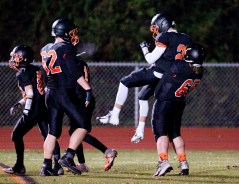 Watertown's Samuel St.. Hilaire (2) is lifted by teammate Kyle Robinson (65) as they celebrate a touchdown during their game against Sacred Heart-Kaynor Tech's Friday at Watertown High School. Jim Shannon Republican American
