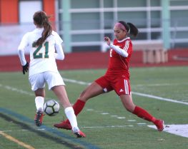 Wolcott High School's Alexandra Arteaga tries to stop Holy Cross High School's Devon Bushka from dribbling the ball up the sideline during the NVL Girls' Soccer Tournament semi-final girls varsity soccer game in Watertown on Tuesday. Emily J. Reynolds. Republican-American