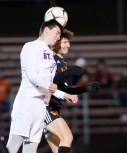 St. Paul's Will Barton (13) and Watertown's Miron Jusufi (10) both go up for the ball during their NVL boys soccer semi-final game Tuesday at Crosby High School. Jim Shannon Republican American