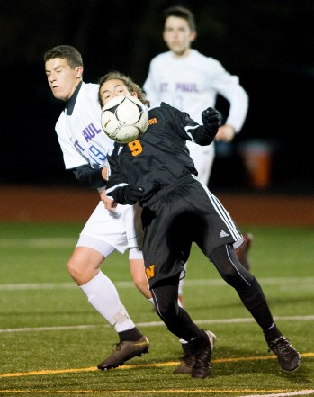 Watertown's Troy Tedesco (9) settles the ball and get control while being defended by St. Paul's Patrick Carbone during their NVL boys soccer semi-final game Tuesday at Crosby High School. Jim Shannon Republican American