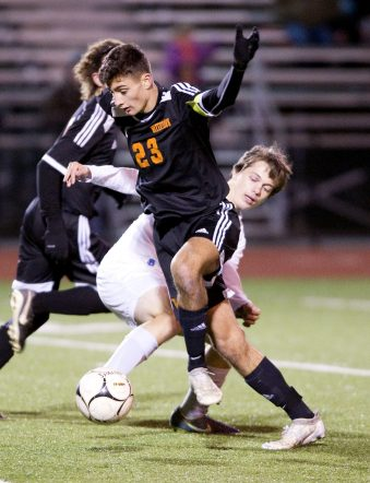 Watertown's Anthony Longo (23) gets around St. Paul's Matthew Stephani (5) during their NVL boys soccer semi-final game Tuesday at Crosby High School. Jim Shannon Republican American