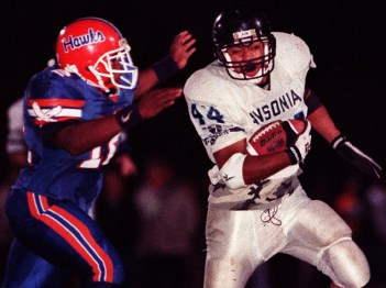 1998: Ansonia #44 Tobias Freeman avoids the tackle of Bloomfield #16 Jason Manson during their game in West Haven on Saturday. (RA)