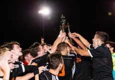 Watertown players celebrate with the trophy after defeating Woodland 2-0 and winning the boys NVL Championship game between Watertown and Woodland Regional at Naugatuck High School in Naugatuck on Thursday. Bill Shettle Republican-American