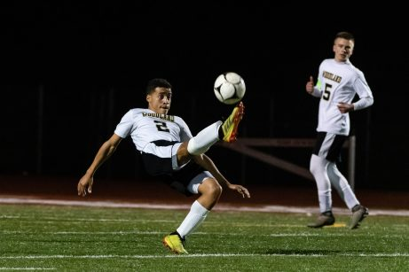 Woodland's Jason Claiborn #2 performs a bicycle kick clearing ball out of trouble during the boys NVL Championship game between Watertown and Woodland Regional at Naugatuck High School in Naugatuck on Thursday. Bill Shettle Republican-American