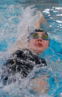 Torrington's Julia Mccarthy swims the backstroke during the during the NVL finals at Kennedy High School Friday night. McCarthy won with a time of1:00.59. Seymour won the NVL title with an overall score of 755.5. Michael Kabelka / Republican-American