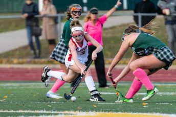 Cheshire forward Mikayla Crowley #3 stick handles the ball against Guilford midfielder Janie Danaher #21 during the SCC Championship game between Cheshire and Guilford at Guilford High School in Guilford on Saturday. Guilford cameback immediately scoring two goals to win 3-1, winning the SCC Title. Bill Shettle Republican-American