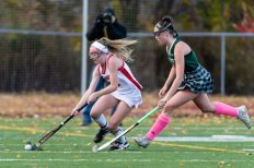 Cheshire's Mikayla Crowley #3, left controls the ball as she runs past Guilford's Hannah Tillier #17 during the SCC Championship game between Cheshire and Guilford at Guilford High School in Guilford on Saturday. Guilford scored two unanswered goals, after Cheshire tied it up to win 3-1, winning the SCC Title. Bill Shettle Republican-American