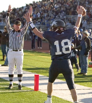 2006: Ansonia's Talor King celebrates his 11-yard touchdown reception from Tristan Roberts during their 34-12 win over Bloomfield in the Class S finals Saturday at Jess Dow Field on the SCSU campus in New Haven. (RA)
