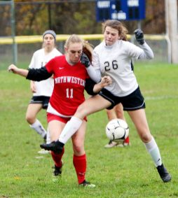#11 Kelly Worthington of Northwestern and #26 Molly Hussey of Woodland battle for the ball during CIAC Class M girls soccer tournament action in Winsted Monday. Steven Valenti Republican-American