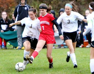 #7 Emma Propfe of Northwestern keeps the ball from #1 Karly Laliberte and #3 Nicole Sherman of Woodland during CIAC Class M girls soccer tournament action in Winsted Monday. Steven Valenti Republican-American