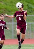 Naugatuck's Jake Corbo #8 heads the ball to a teammate during the first round of the CIAC Class LL boys' soccer tournament between #22 Newtown and #11 Naugatuck at Naugatuck High School in Naugatuck on Tuesday. Naugatuck beat Newtown 1-0 and advances to the next round on Thursday. Bill Shettle Republican-American