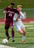 Naugatuck's Kareem Morris #23 tries to hold off Newtown's Tanner Trede #21, getting to the ball during the first round of the CIAC Class LL boys' soccer tournament between #22 Newtown and #11 Naugatuck at Naugatuck High School in Naugatuck on Tuesday. Naugatuck beat Newtown 1-0 and advances to the next round on Thursday. Bill Shettle Republican-American