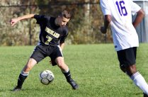 #7 Devon Polletta of Woodland controls the ball as #16 Kode Smith of Aerospace defends during CIAC Class M soccer action in Beacon Falls Wednesday. Steven Valenti Republican-American