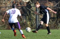 #16 George Hughes of Woodland takes a shot as #18 Aboubacar Barrie of Aerospace defends during CIAC Class M soccer action in Beacon Falls Wednesday. Steven Valenti Republican-American