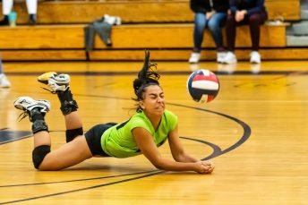Kennedy's Ariana Padilla #00 makes a diving save on the ball during the second round of the CIAC Class L girl's volleyball tournament between #11 North Haven and #6 Kennedy at Kennedy High School in Waterbury on Thursday. Kennedy won three matches to none and advances to the Class L quarterfinals. Bill Shettle Republican-American