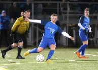Lewis Mills High School's Madison Hallet kicks the ball up the field during the CIAC Class M semifinal girls varsity soccer tournament game on Falcon Field in Meriden against Morgan High School on Monday. Emily J. Reynolds. Republican-American