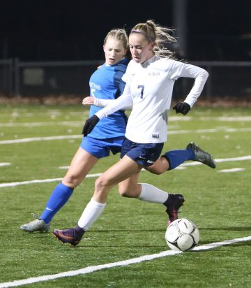 Lewis Mills High School's Grace Buchanan and Morgan High School's Chloe Bousquet battle for the ball during the CIAC Class M semifinal girls varsity soccer tournament game on Falcon Field in Meriden on Monday. Emily J. Reynolds. Republican-American