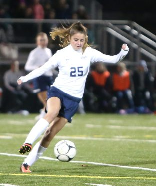 Morgan High School's Madison Emmi kicks the ball up the field during the CIAC Class M semifinal girls varsity soccer tournament game on Falcon Field in Meriden against Lewis Mills High School on Monday. Emily J. Reynolds. Republican-American