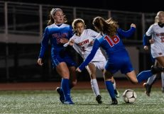 Watertown's Sophia Guerrera #2 battles with Tolland's Eva Riggott #16 for control of the ball, with Tolland's Charlotte Gerow #22 looking on during the Girls Soccer Class L Semifinal game between Watertown and Tolland at Veterans Memorial Stadium at Willowbrook Park in New Britain on Monday. Tolland beat Watertown 2-1 and advances to the Class L finals. Bill Shettle Republican-American