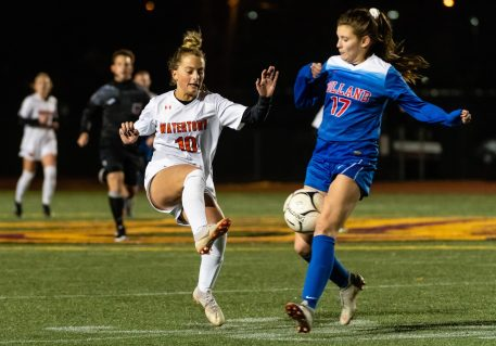 Watertown's Meadow Mancini #10 pass is blocked by Tolland's Natalie Lyon #17, defending during the Girls Soccer Class L Semifinal game between Watertown and Tolland at Veterans Memorial Stadium at Willowbrook Park in New Britain on Monday. Tolland beat Watertown 2-1 and advances to the Class L finals. Bill Shettle Republican-American