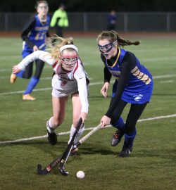 Cheshire High School's Mikayla Crowley battles Newtown High School's Katherine Goyda during the Class L semifinal game in Watertown on Tuesday. Emily J. Reynolds. Republican-American