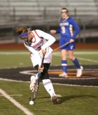 Cheshire High School's Sophie Cremo takes the ball up the field in front of Newtown High School's Alison Kelleher during the Class L semifinal game in Watertown on Tuesday. Emily J. Reynolds. Republican-American