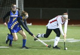 Cheshire High School's Anne Eddy battles Newtown High School's Isabella Butler during the Class L semifinal game in Watertown on Tuesday. Emily J. Reynolds. Republican-American