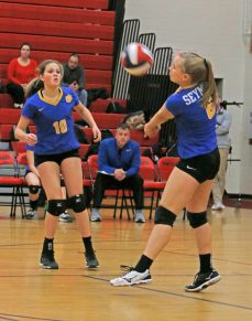 SeymourÕs Victoria Sampiere #6 returns the ball against Woodland as Jacey Cosciello looks on in Class M semi-final Volleyball tournament at Pomperaug High School Tuesday night. Seymour won 3-0. Michael Kabelka / Republican-American.